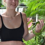 Girl holding a red tailed racer (rat snake) - harmless.